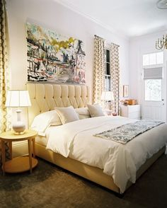 tufted headboard-gorgeous art. creamy creamy white, warm and cozy. Finally something I like-it looks grown-up with a touch of whimsy and seems to have good balance even though the art is oversized it seems to fit the large room too.