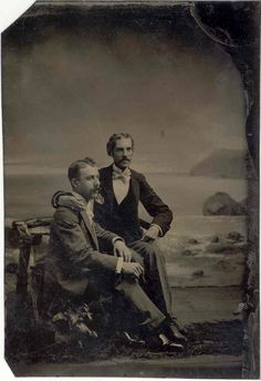 A lovely seaside scene in the backdrop for this affectionate pair, stopping to have their photograph taken together while visiting the coast, perhaps? A great many early photographers set up in seaside towns, the souvenir photograph being a fine. Vintage Backdrop, Seaside Towns, Gay Couple, Vintage Men, Erotic, Backdrops, Scenery, Coast, Romantic