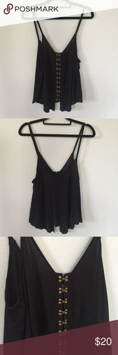 Silence + Noise Black Hook Eye Cami Super cute black tank from silence + noise. Has brassy colored hook eye clasps down the front and light & flowy feel. Is made of 100% rayon. V-neck front and low scoop back. Worn only once & in perfect condition! Size XS but has a loose fit. Perfect summer tank to pair with your favorite jean shorts ☀️ Urban Outfitters Tops Tank Tops
