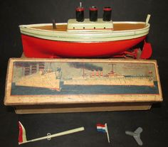 Carette 1913 Imperator boat liner original box key mast flag works bing Germany Paint Keys, Cracked Paint, Vintage Boats, Motor Works, Vintage Candy, Tin Toys, Wooden Boats, Classic Toys, Battleship