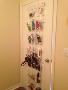 An Over The Door Shoe Organizer As A Bathroom And Hair Products Organizer.