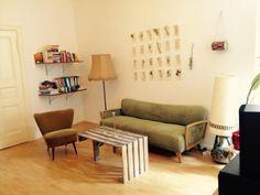 ein wohnzimmer ganz im vintage look das sofa und der sessel bringen ein tolles retro
