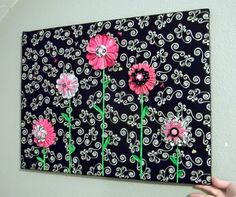 Kanzashi flowers on fabric covered canvas