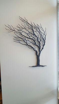 Wind blown metal tree art.