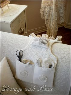 A Couch Caddy.  I need to make this for my mom.  No more needles in the arm of the couch. :)
