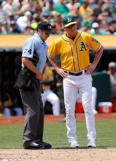 Oakland Athletics manager Bob Melvin, Home plate umpire John Tumpane