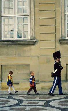 Denmark's royal guards warn off people who sit on the steps of Amalienborg Palace, Queen Margrethe II's Copenhagen residence. The much-loved queen insists, however, that the guards make an exception for local preschoolers who like to eat their play lunches there.