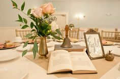 Wedding centerpiece idea: Use a mixture of antique brass items and old books at the center of each table | Chocksett Inn and Restaurant, Gardner, MA | Cleopatra Photography