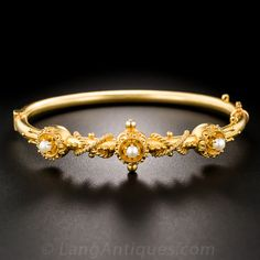 A precious and pristine Victorian rarity, lovingly crafted in rich and velvety 18K yellow gold, featuring a lustrous trio of small seed pearls embellished with delicate Etruscan Revival style granulation work. A classic Victorian treasure for a smallish wrist.