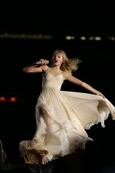 Taylor performing love story during the red tour