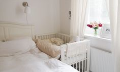 Baby bed attached to parent's bed. - Not in bed with you, not too far away...