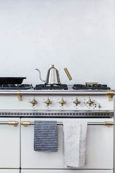 Lovely Lacanche stove in white enamel with brass and stainless trim. Via clairesfieldnotes.tumblr.com