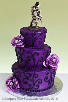 Topsy turvy purple cake with skeleton bride...