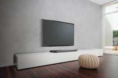 This slim sound system is compact enough to fit beneath your TV, yet fills the room with powerful audio from four speakers & dual subwoofers