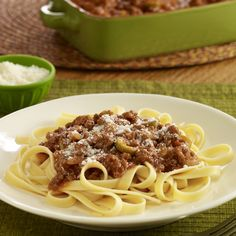 A Latin-inspired Bolognese sauce recipe with ground beef, chorizo, sliced olives, adobo seasoning and tomato sauce served over pasta from Hunt's & Kraft!  Kraft is a brand of Kraft Foods Inc.