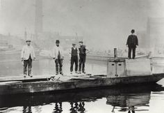 """Caption: """"Men on a boat in Paddington Basin on the Grand Junction Canal"""" 8 April 1909"""