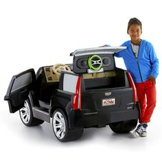 Check out the Power Wheels Cadillac Escalade at the official Fisher-Price website. Explore all our Power Wheels ride-on vehicles, batteries and accessories today! Kids Ride On Toys, Toy Cars For Kids, Kids Toys, Kids Power Wheels, Power Wheels Jeep, Baby Dolls For Kids, Toys For Girls, Rangement Makeup, Nerf Toys