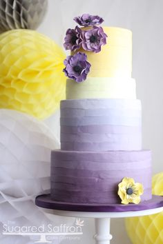 Purple and Yellow anemone cake - Ombre purple and yellow cake with anemones. TFL