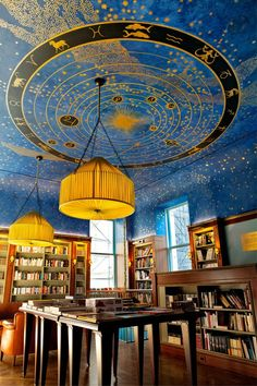 """Albertine"" New York's new French bookstoreThe second-floor ceiling, a stylized representation of the universe with Zodiac signs and planets in gold and silver, was inspired by a fresco created for Florentine Renaissance Prince Cosimo de' Medici."