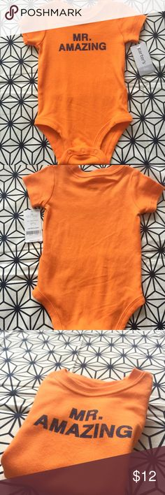 """Carter's Onesie Cute Onesie by the brand Carter's in size 6 months. Featuring words """"Mr Amazing"""".                                                                          ✅ New with Tags.    ✅ Discount available when you bundle.               ❌ Price is firm unless bundled.                     ❌ No Trades. Carter's One Pieces"""