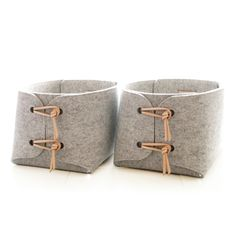 storage baskets with natural leather details Two large