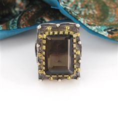 $367.95 Topaz Large smoky topaz rectangle is nestled in gold and set on oxidized sterling silver decorated with gold dots and silver swales. Striking ring with a vintage feel. Handcrafted and one of a kind.