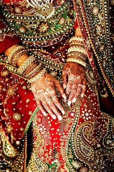 i like the vibrant red, green & gold colors, all the embroidery & embellishment, and the chunky bangles