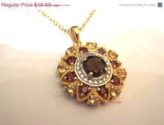 Vintage jewelry amethyst and garnet CZ stones in a vermeil sterling setting