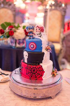 Superhero-Themed Wedding Cake! #superherowedding - Visit to grab an amazing super hero shirt now on sale!