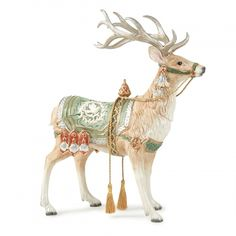 This stunning Christmas collection in soft, muted pastel greens and ivory will enhance your holiday season as well as your everyday home design. The Gregorian Collection Centerpiece Deer Figurine is the largest of the deer figurines produced by Fitz and Floyd over the years.  A popular customer favorite, this reindeer figurine is sure to become a focal point of your holiday home decor.  Soft gold trim and tassels enhance the pastel green and ivory saddle.  Combine with coordinating holidy…