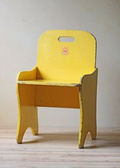 vintage child size wooden chair yellow.