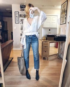 What I Wore. I am wearing a white, faux wrap blouse, Levi's Wedgie Straight Jeans, Black booties, and a large woven tote. Capsule Wardrobe Mom, Casual Winter Outfits, Outfit Winter, Simple Outfits, Summer Outfits, Outfit Jeans, Blouse Outfit, Boating Outfit, Sweaters And Jeans