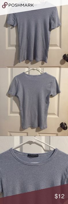 Brandy Melville Striped Tee Brandy Melville Striped tee shirt. Super cute and casual! Very soft knit and can fit XS-S! Pretty much brand new! Never worn or washed. ** NO TRADES** Brandy Melville Tops Tees - Short Sleeve