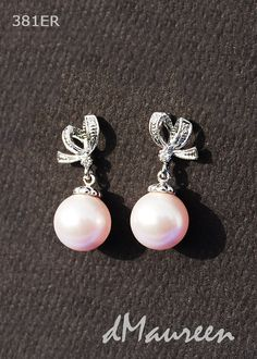 381ER Pink Pearl Tie the Knot white gold earrings with cz ribbons. Made of rhodium white gold plated brass with sterling silver posts, butterfly