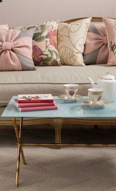 I love the pillows tossed on the sofa and the blue on the table - so breezy and feminine.  Joss  Main