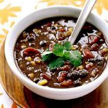 Weight watchers spicy black bean soup- 5pts+  Prepare: 30min Cook: 10min 8 Servings  Ingredients 1 spray(s) cooking spray  1 med onion(s), finely chopped  4 med garlic clove(s), minced  (3) 15oz canned black beans, undrained 1/2 tsp red pepper flakes, or to taste  1 tsp ground cumin  14 1/2 oz vegetable broth  10 oz canned tomatoes with green chilies 11 oz canned yellow corn, drained  Cilantro
