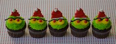 Adorable Grinch cupcakes for snacks during an outdoor movie party - A Southern Outdoor Cinema movie snack & food idea for backyard movie night.