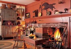 Dignified Windsor chairs join primitive collections in a hearth room.  ... beautiful!