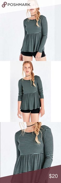 "Kimchi Blue Long Sleeve Striped Peplum Top  Perfect For Fall  It's love at first stripes in this ribbed knit peplum tee from Kimchi Blue. Soft + stretchy with fitted long-sleeves, a banded crew neck and shirred babydoll waist that tapers out for a modern silhouette. Content + Care - Polyester, rayon, Spandex - Machine Wash - Measurements: Chest: 29"" - Length: 24.5"" Urban Outfitters Tops Tees - Long Sleeve"