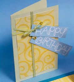 Birthday Cards for Him By Caitlin Berens Gift-Wrapped Birthday Card:   Layer a piece of decorative paper onto a cardstock card, then use ribbon to give it a gift-wrapped effect. Attach two playful tags and use large letter stickers to wish the recipient a happy birthday.