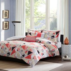 The Intelligent Design Mackenzie Duvet Cover Set brings fun and modern together with this triangle design. Printed on microfiber, the triangles use taupe, grey, black and a reddish pink to create this design. Two decorative pillows use triangles and coordinating colors from the top of bed to pull this look together.