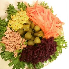 Summer salad with kale, tuna, sweet corn, carrots