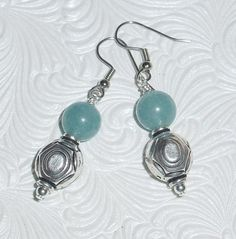 Dyed Aquamarine Beads with Pewter on a surgical steel earwire. They measure just under 2 inches in total length. This is a great little earring for work or play. Bead Earrings, Wedding Themes, Blue Wedding, Sterling Silver Earrings, Pewter, Sparkle, Weddings, Play, Steel