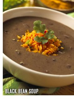 Warm up with our Black Bean #Soup, served with wild rice and sour cream. Click to view recipe.
