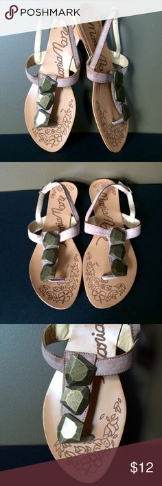 Maria Mare Pink Leather T-Strap Sandals These sandals are the cutest! Clay pink leather straps with stone detail. Floral etching along foot with small metallic heel. A few nicks on the heel, but overall good condition! Maria Mare Shoes Sandals
