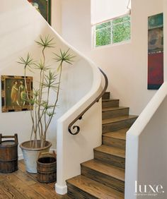 Neutral Mediterranean Entryway and Staircase