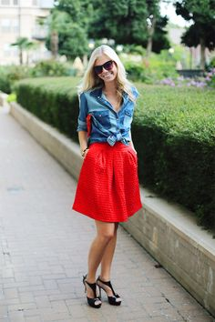 Team a blue denim shirt with a red full skirt to get a laid-back yet stylish look. Polish off the ensemble with black leather heeled sandals. Red Skirts, Cute Skirts, Mini Skirts, Blue Denim Shirt, Chambray Top, Denim Blouse, Denim Top, Red Mini Skirt, Jeans Bleu