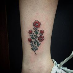 Traditional Tattoo — tattoofilter: Flower tattoo on Tainara's ankle....