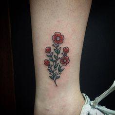 Traditional Tattoo — tattoofilter: Flower tattoo on Tainara's ankle....