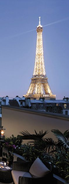 Sip a glass of French wine out on the terrace overlooking the Eiffel Tower.